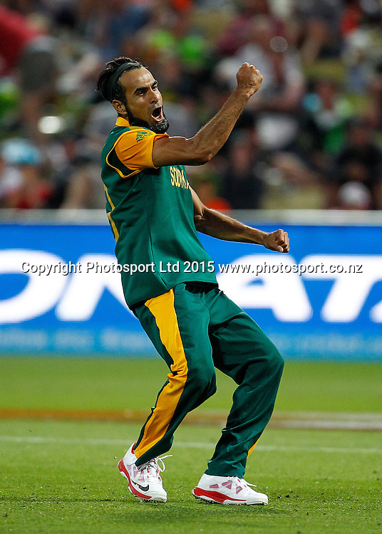 South Africa's Imran Tahir celebrates a wicket during the ICC Cricket World Cup match - South Africa v Zimbabwe at Seddon Park, Hamilton, New Zealand on Sunday 15 February 2015.  Photo:  Bruce Lim / www.photosport.co.nz