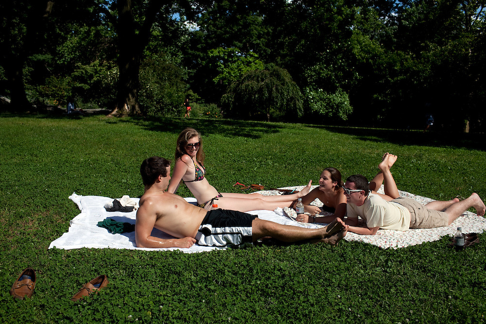 Jonathan Luke, Emma Curry, Katie Ward and Travis Wardlow sunbathe in Isham Park alongside the Inwood 207 Street subway stop at the very northern end of New York on June 23, 2012.
