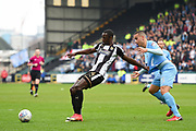 Notts County forward Jonathan Forte (14) holds off Coventry City's Rod McDonald (5) during the EFL Sky Bet League 2 match between Notts County and Coventry City at Meadow Lane, Nottingham, England on 7 April 2018. Picture by Jon Hobley.