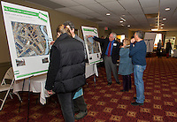 Jeanne Compton and David Hohenschau discuss ideas for Land Use - Downtown with another group discussing Weirs Beach during Re Imagine Laconia at the Opechee Conference Center on Wednesday evening.  (Karen Bobotas Photographer)