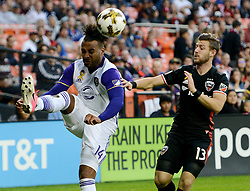 September 9, 2017 - Washington, DC, USA - 20170909 - Orlando City FC forward GILES BARNES (14) gets a pass away against D.C. United midfielder PAUL ARRIOLA (13) in the first half at RFK Stadium in Washington. (Credit Image: © Chuck Myers via ZUMA Wire)