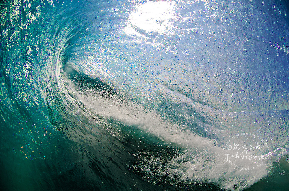 Completely inside the tube of a powerful breaking wave in Hawaii