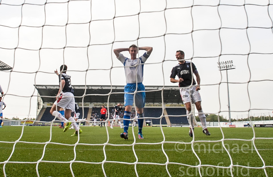 Falkirk's players cele after Queen of the South's Chris Higgins (6) scores an own goal.<br /> Falkirk 1 v 1 Queen of the South, Scottish Championship game played today at The Falkirk Stadium.