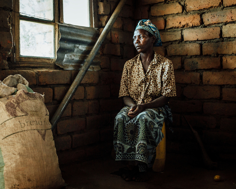 "Swema Adini, 36, Namungume Village, Malawi. ""I lost my husband."" 