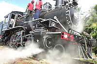 Steam locomotive crew checks his engine after the speed competition at the sugar factory of Cardenas city, about 150 km at East of Havana, Friday November 21, 2003, Cardenas, Cuba. Between November 20th and 30th, 2003, will be held in Cuba, the Steam International Festival, featuring tours throughout the country. In this festival participated railroad workers who drive the old steam engines, many of them still at service after nearly three centuries. (Photo/Cristobal Herrera)
