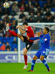 Cardiff Defender Mark Hudson (ENG) kicks upfield as Watford Forward Troy Deeney (ENG) shields himself during the second half of the match - Photo mandatory by-line: Rogan Thomson/JMP - Tel: Mobile: 07966 386802 23/10/2012 - SPORT - FOOTBALL - Cardiff City Stadium - Cardiff. Cardiff City v Watford - Football League Championship