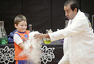 Middletown, New York - Erik Maldonado, right, hands a beaker full of water and dry ice to a boy during a Mad Science demonstration at Middletown YMCA summer camp on Aug. 20, 2010.