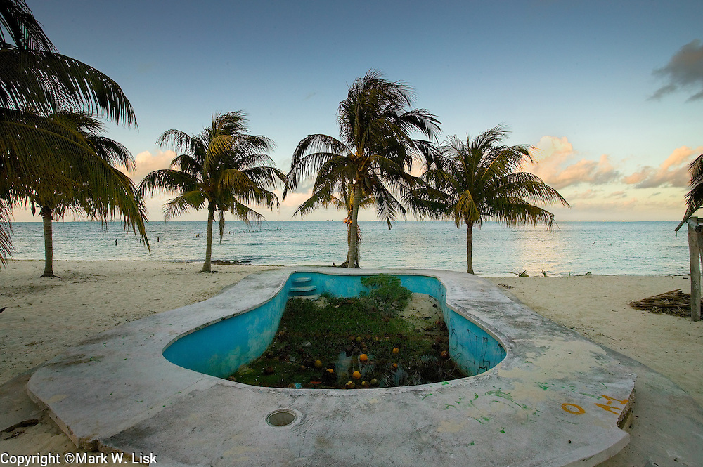 Coconuts fill a swimming pool on the Isla Mueres, showcasing the devistation from huricanes across the Caribbean, Mexico.