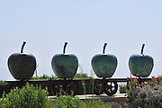 Israel, Upper Galilee, Metula, (founded 1896) is situated on the Lebanese boarder Modern outdoor art Apples on a Train