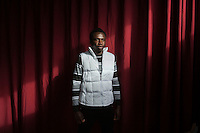 SALEMI, ITALY - 9 DECEMBER 2014: Omar, a 23 years old asylum seeker from Gambia who works as a cook, poses for a portrait at the CAS (Special Accommodation Center) in Salemi, Italy, on December 9th 2014.<br /> <br /> Omar is a Dublin case who deported from Spain to Senegal in 2009. Omar studied cooking in Gambia when he left to Venezuela to continue his studies. He then traveled to Spain, where he was caught and deported to Senegal. After Senegal, he went to Burkina Faso, Mali and Libya. He stayed in Libya 2 years and then embarked on a smugglers' vessel with other migrants to cross the Mediterrean Sea. Their boat was rescued and escorted to the port of Trapani, Sicily.<br /> <br /> The CAS (Special Accommodation Center) in Salemi, Sicily, hosts a total of 77 migrants from Nigeria, Mali, Togo Senegal, Gambia, Bangladesh, Camerou, Egypt, Ivory Coast, Burkina Faso and Pakistan.