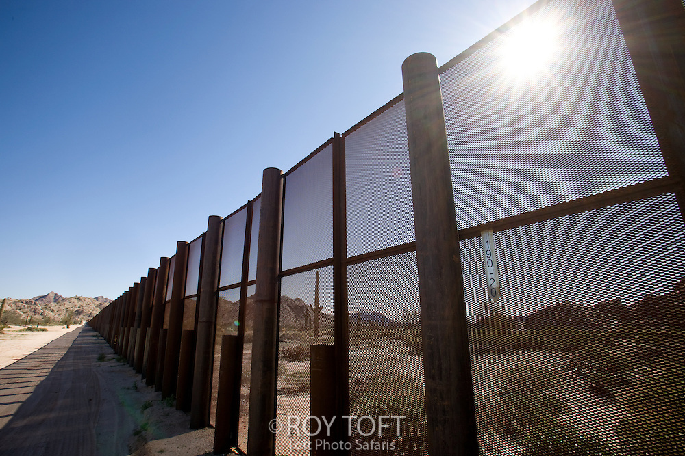 "US/Mexican border fence at N. 32""15.184, W.114""01.116 at Berry Goldwater Range, Arizona."