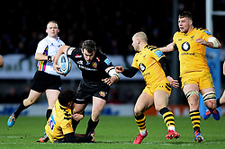 Ian Whitten of Exeter Chiefs is tackled by Jacob Umaga of Wasps - Mandatory by-line: Ryan Hiscott/JMP - 30/11/2019 - RUGBY - Sandy Park - Exeter, England - Exeter Chiefs v Wasps - Gallagher Premiership Rugby