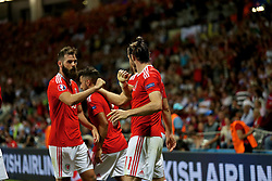 TOULOUSE, FRANCE - Monday, June 20, 2016: Wales' Gareth Bale celebrates scoring the third goal against Russia, with team-mate Joe Ledley, to seal a 3-0 victory and top Group B during the final Group B UEFA Euro 2016 Championship match at Stadium de Toulouse. (Pic by David Rawcliffe/Propaganda)
