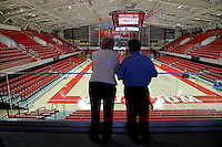 Athletics Director Debbie Yow (left) chats with a member of the media tour of the newly refurbished Reynolds Coliseum.