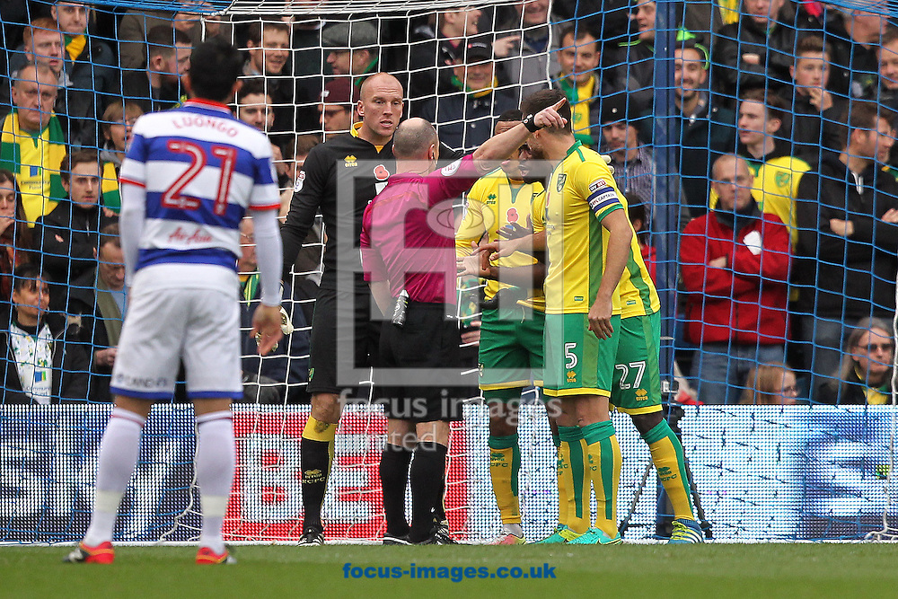 Russell Martin of Norwich leads the protests as Martin Olsson of Norwich is sent off by Referee Scott Duncan after handling the ball to stop a QPR goal during the Sky Bet Championship match at the Loftus Road Stadium, London<br /> Picture by Paul Chesterton/Focus Images Ltd +44 7904 640267<br /> 19/11/2016