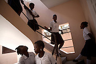 CLIENT: LUTHERAN WORLD RELIEF <br /> <br /> Students at Antoinette Dessalines girls school, recipients of hygiene kits donated by Lutheran World Relief, walk down a staircase at the school in St. Marc, Haiti.