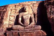 SRI LANKA, BUDDHISM The Gal Vihara Buddha, 23 feet tall, cut  from solid rock, carved in the 12th.C at Polonnaruwa