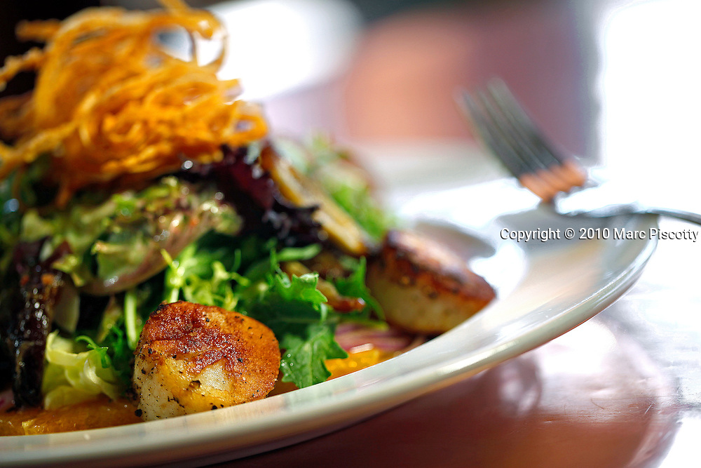 SHOT 9/2/10 2:36:32 PM - LoHi Steakbear food and drink menu items at the Denver, Co. neighborhood bar and restaurant. Broiled scallop salad with red onion, orange, sliced beets, dates, minced greens and house vinaigrette $16. (Photo by Marc Piscotty / © 2010)