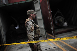 60144147 <br /> A police officer guards during the inspection of a container with military equipments aboard the Chong Chon Gang vessel from the Democratic People s Republic of Korea (DPRK), at the Manzanillo International container terminal on the coast of Colon City, Panama, July 17, 2013. The Democratic People s Republic of Korea (DPRK) on Thursday demanded the release of a vessel seized in Panama suspected of carrying narcotic drugs and banned arms, claiming the weapons were being transported under a legitimate contract with Cuba, the official KCNA news agency reported,<br /> Wednesday, 17th July 2013<br /> Picture by imago / i-Images<br /> UK ONLY