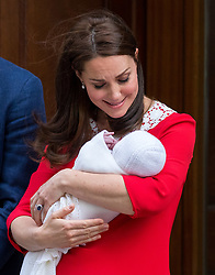 © Licensed to London News Pictures. 23/04/2018. London, UK. The Duchess of Cambridge leaves the Lindo Wing of St Mary's Hospital in west London with the Duke of Cambridge (not pictured) and their new born baby son, the Prince of Cambridge. Their third son was safely delivered at 11:01 AM today, and weighed 8lbs 7oz. He is fifth in line to the throne. Photo credit : Tom Nicholson/LNP