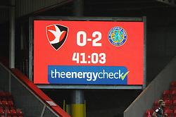 A screen displays the score during the first half   - Mandatory by-line: Nizaam Jones/JMP- 26/01/2019 - FOOTBALL - LCI Rail Stadium -Cheltenham, England - Cheltenham Town v Macclesfield Town - Sky Bet League Two