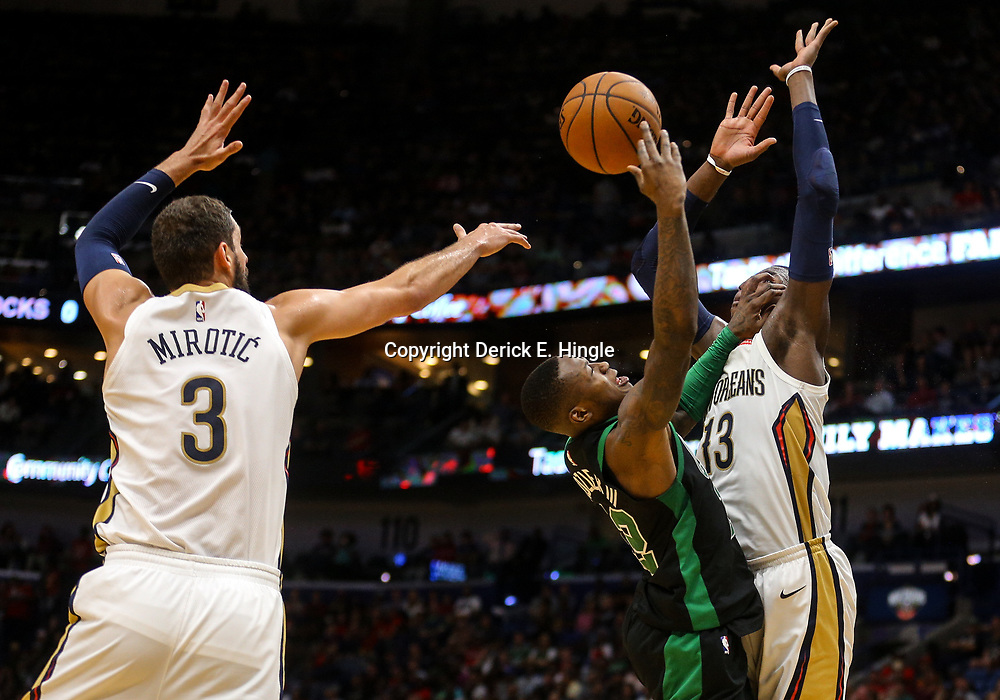 Mar 18, 2018; New Orleans, LA, USA; Boston Celtics guard Terry Rozier (12) has his shot blocked by forward Cheick Diallo (13) as forward Nikola Mirotic (3) defends during the second half at the Smoothie King Center. The Pelicans defeated the Celtics 108-89. Mandatory Credit: Derick E. Hingle-USA TODAY Sports