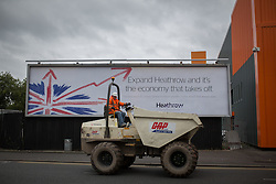 © Licensed to London News Pictures . 13/10/2014 . Manchester , UK . A billboard on Hyde Road in Manchester , promoting the expansion of Heathrow Airport in the South East of England as an economic benefit to Britain . Photo credit : Joel Goodman/LNP