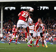 Patrick Bamford winning header in a crowded box as boro went all out attack looking for an equilizer during the Sky Bet Championship match between Fulham and Middlesbrough at Craven Cottage, London, England on 25 April 2015. Photo by Matthew Redman.