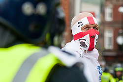 "An EDL supporter and Police in full Riot kit on the streets close to Rotherham Town Hall shortly before the start of the English Defence Leagues ""Justice for the Rotherham 1400"" March on Saturday Afternoon which was described by an EDL Facebook Page as ""a protest against the Pakistani Muslim grooming gangs"" <br /> <br /> Image © Paul David Drabble <br /> www.pauldaviddrabble.co.uk"