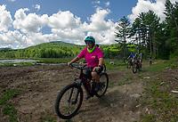 Sara Caveney guides an EBike tour around Rock Loop Trail at Gunstock on Tuesday morning.  (Karen Bobotas/for the Laconia Daily Sun)