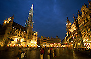 Brussels, Belgium. Grand Place and City Hall (Hotel de Ville), left.