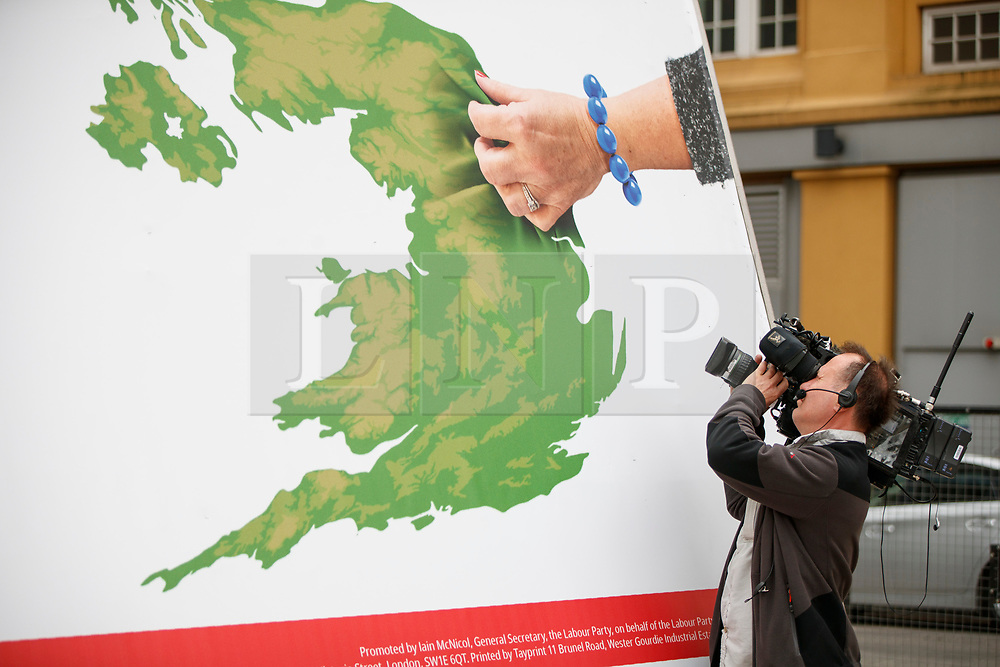 © Licensed to London News Pictures. 11/05/2017. London, UK. A member of press is at unveiling of Labour party's new election campaign poster in South Bank, London after Labour leader Jeremy Corbyn pulled out of the event following the manifesto leak on 11 May 2017. Photo credit: Tolga Akmen/LNP