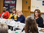 "24 MAY 2019 - WEST DES MOINES, IOWA: US Senator KIRSTEN GILLIBRAND (D-NY), center, chairs a community forum in the West Des Moines Public Library. Gillibrand unveiled her ""Family Bill of Rights"" during a forum in West Des Moines. The New York Senator has made family health and rights a centerpiece of her campaign. She is touring Iowa this week to support her candidacy to be the Democratic nominee for the US Presidency. Iowa traditionally hosts the the first selection event of the presidential election cycle. The Iowa Caucuses will be on Feb. 3, 2020.           PHOTO BY JACK KURTZ"
