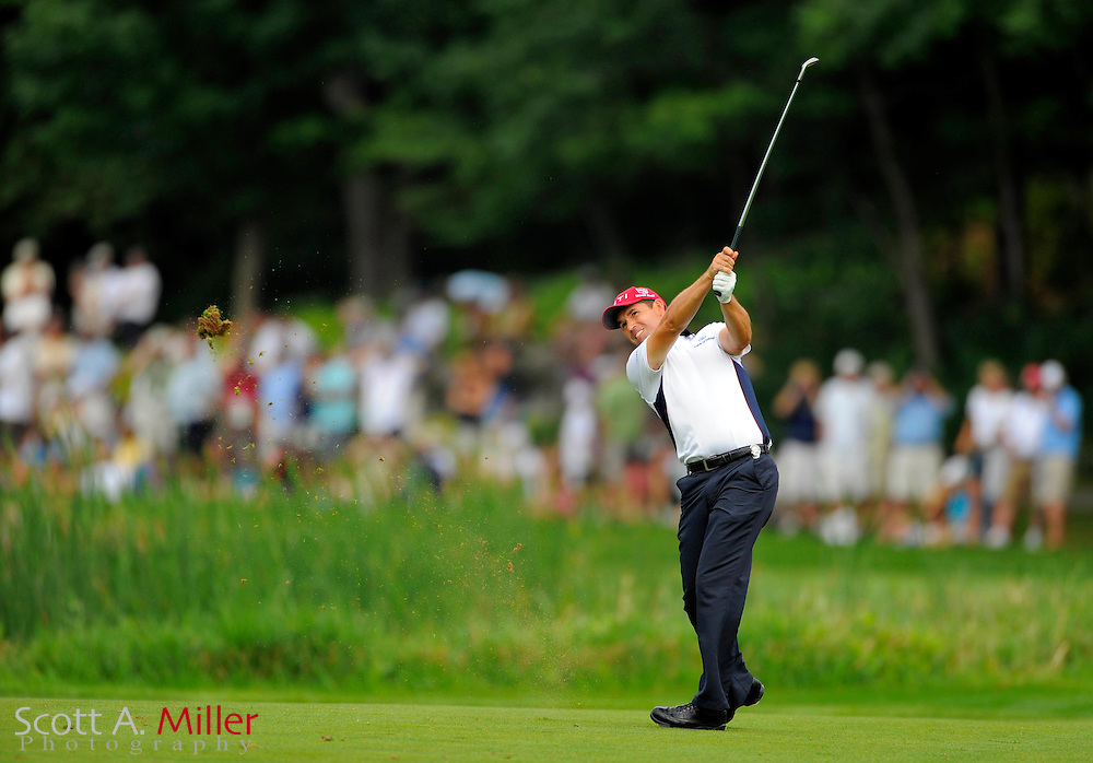 Aug 15, 2009; Chaska, MN, USA; Padraig Harrington (IRL) hits his second shot on the 16th hole during the third round of the 2009 PGA Championship at Hazeltine National Golf Club.  ©2009 Scott A. Miller