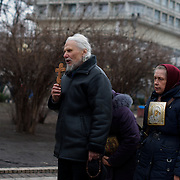 KIEV, UKRAINE - February 25, 2014: People pray at a shrine in a park beside Ukraine's parliament building in Kiev. CREDIT: Paulo Nunes dos Santos