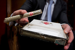 © Licensed to London News Pictures. 24/01/2013. London, UK. A Bonham's employee holds a box containing a cigar previously owned by World War Two British Prime Minister Sir Winston Churchill (est. GB£500-800) at the press view for the 'Bonham's Gentleman's Library Sale' in Knightsbridge, London, today (24/01/13). The sale, made up of weird, wonderful, rare and practical items, - all fit for a gentleman's library - is set to take place at 10am on the 24th of January at the auction house's Knightsbridge premises. Photo credit: Matt Cetti-Roberts/LNP