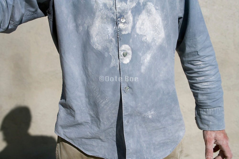 shirt of person whom has been sanding plasterboard