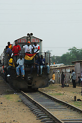 Ghana, Accra, 2007. A commuter train is beseiged by celebrants on March 6th, Ghana's fiftieth Anniversary of Independence.