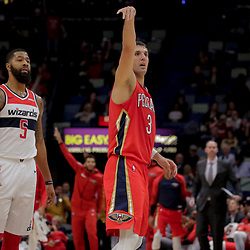 Nov 28, 2018; New Orleans, LA, USA; New Orleans Pelicans forward Nikola Mirotic (3) reacts after a three point basket against Washington Wizards forward Markieff Morris (5) during the second half at the Smoothie King Center. Mandatory Credit: Derick E. Hingle-USA TODAY Sports