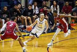 Nov 28, 2018; Morgantown, WV, USA; West Virginia Mountaineers guard Chase Harler (14) dribbles through a press during the second half against the Rider Broncs at WVU Coliseum. Mandatory Credit: Ben Queen-USA TODAY Sports