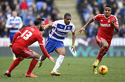 Reading's Garath McCleary takes in Nottingham Forest's Daniel Fox and Nottingham Forest's Michael Mancienne - Photo mandatory by-line: Robbie Stephenson/JMP - Mobile: 07966 386802 - 28/02/2015 - SPORT - Football - Reading - Madejski Stadium - Reading v Nottingham Forest - Sky Bet Championship