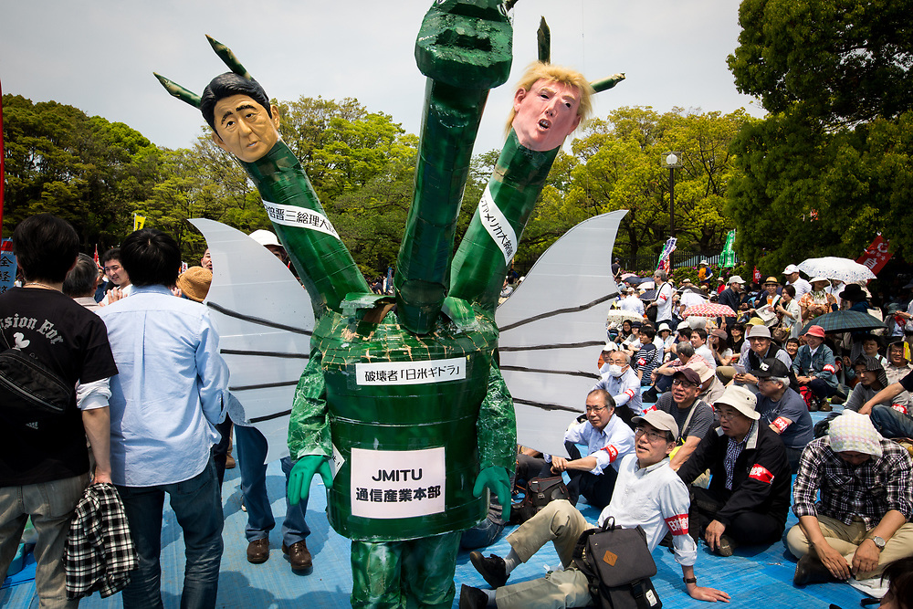 TOKYO, JAPAN - MAY 1 : A demonstrator wearing a costume with a dragon head, Shinzo Abe and Donald Trump effigies joins thousands of labor union demonstrators during the May Day Rally at Yoyogi Park on May 1, 2017 in Tokyo, Japan. (Photo by Richard Atrero de Guzman/NUR Photo)