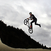 Brandon Docsh in action during the 'Red Bull Roast It' BMX competition with riders from around the globe competing at the Gorge Road Jump Park, Queenstown, South Island, New Zealand. 18th February 2012. Photo Tim Clayton