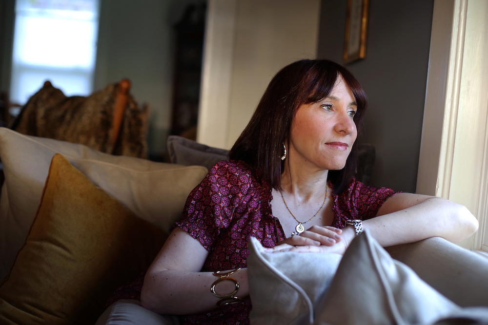 Xavier Mascareñas/Newsday; Andrea Ziltzer, 50, who lost her mother to breast cancer, made the decision five years ago to have a double mastectomy after finding out she was genetically at greater risk for the disease. Ziltzer is photographed in her living room at home in Briarcliff Manor. (May 14, 2013)
