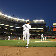 Derek Jeter, New York Yankees, heads out of the dugout wearing number 42 during Jackie Robisnon Day celebrations during the New York Yankees V Chicago Cubs, double header game two at Yankee Stadium, The Bronx, New York. 16th April 2014. Photo Tim Clayton
