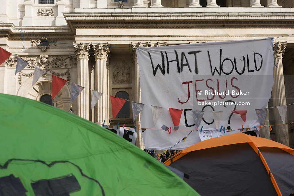 Tents from the Occupy London anti-capitalist protest with the 'What Would Jesus Do?' morality question.