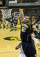 February 19 2011: Michigan Wolverines forward Jordan Morgan (52) dunks the ball during the first half of an NCAA college basketball game at Carver-Hawkeye Arena in Iowa City, Iowa on February 19, 2011. Michigan defeated Iowa 75-72 in overtime.