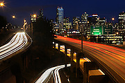 The Seattle skyline glows from the overpass over I-5 at Belmont Ave. E and Lakeview Blvd E. (Ellen M. Banner / The Seattle Times)