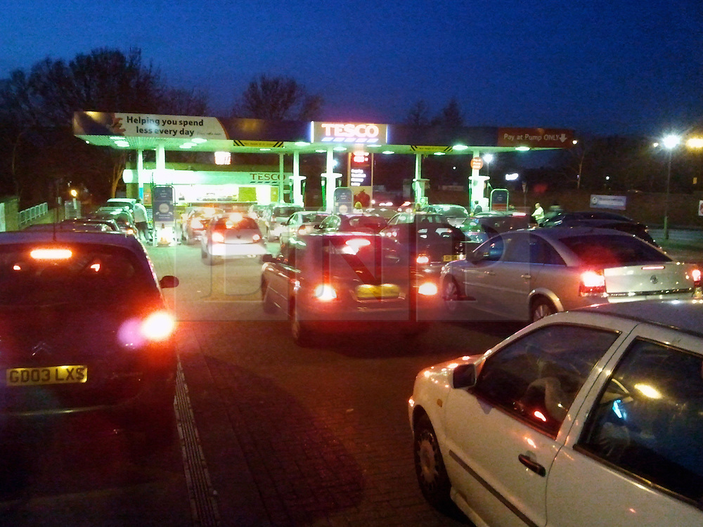 © Licensed to London News Pictures. 29/03/2012 8pm.Panic buying Petrol from night to day! same petrol station with queues at 8pm on 29.03.2012 then again at 9 am on the 30.03.2012..People still Queuing for Petrol.  Panic buying  at Sidcup Tesco Station,in South East London..Photo credit : Grant Falvey/LNP