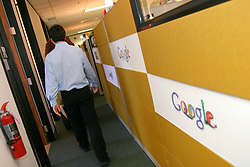 MOUNTAIN VIEW, CALIF., APRIL 8, 2003--GOOGLE--Sergey Brin, Co-Founder & President, Technology  walks  through the halls (past cubicles)  at Google's campus headquarters in Mountain View, Calif. They founded the company in 1998.  Photo by Kim Kulish
